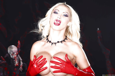 Lusty blonde in latex fetish outfit revealing her big jugs and inviting cage of love