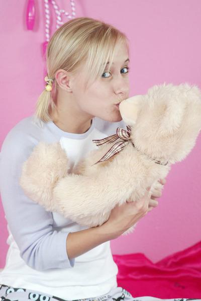 Cute blonde looking alluring in pajamas
