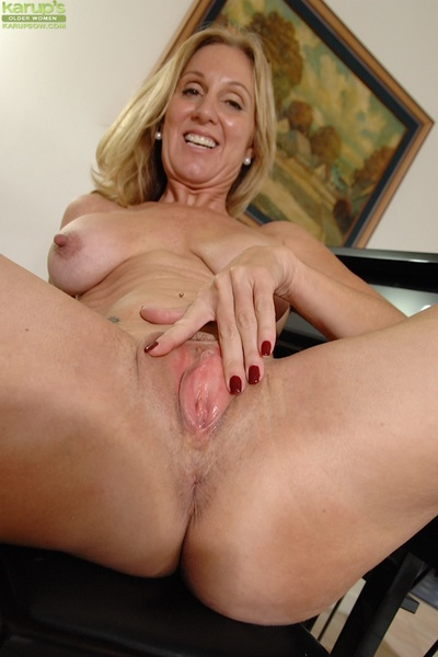 Mature blonde with big love bubbles and teats Jenna spreading that butt