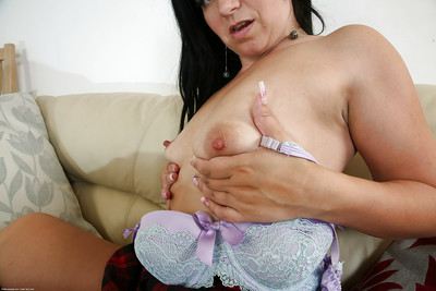 Masturbating mature chick Louise Bassett teases her pussy in strings