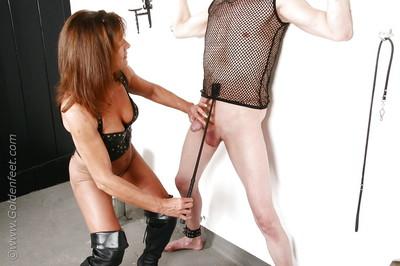 Seasoned UK femdom pornstar Lady Sarah jerking cock in leather petticoat