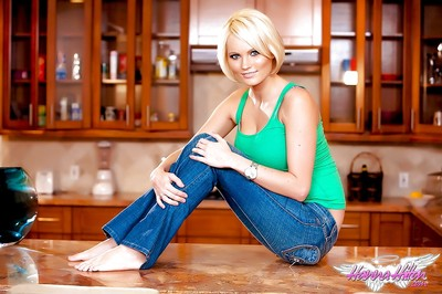 Appealing blonde pornstar Hanna Hilton pulling undies aside to masturbate