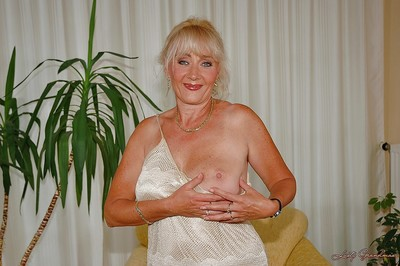 Big titted granny shows her cunt and plays with a massive appliance