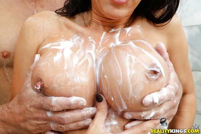 Brunette MILF Lezley Zen having gigantic soaked tits soaoed up in shower