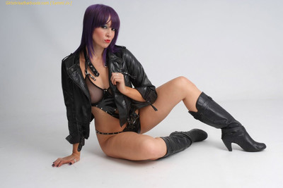 This babe looks stunning in pvc and calf high leather boots with