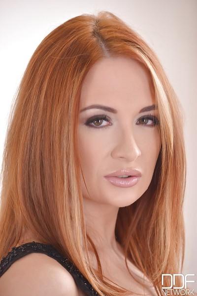 Redheaded European solo girl Eva Berger revealing mini mambos and phat ass