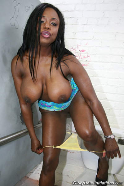 Public restroom is where busty black beauty meets a white strangers cock and has her fun with it.