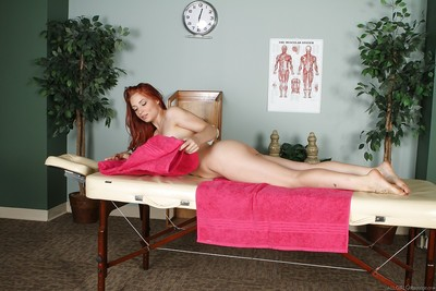 Stunning redhead hottie has a lesbian love making act with her voluptuous masseuse