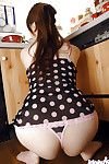 Stunning asian babe with big tits Ai Sayama stripping in the kitchen