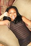 Naughty black model posing sleazy in sheer lingerie