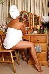 Danica Collins moisturises her body after showering