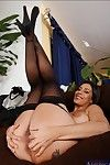 Shapely MILF in black nylons and heels spreads her shaggy pussy