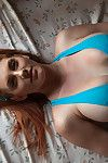 Titsy redhead showering after gym