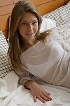Beautiful petite princess posing on the bed