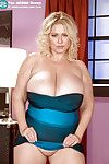 Corpulent blond in blue miniskirt puts her heavy tis and pink pussy on exposure