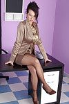 Sexy dressed secretary in satin blouse and satin skirt first showing her pantyhosed feet then she strips not including her skirt and shows off her pantyhosed butt. This babe unbuttons her blouse to reveal her big tits and then plays with her nyloned cunt