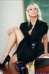 Blond teacher in high heels showing off big ass and mature boobs