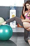 Hot MILF babe Reena Sky slides yoga pants down to reveal string garments ass