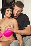 Horny mature lady seducing the young guy next door