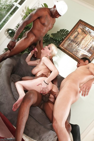 Tattooed golden-haired Cherry Torn in a hardcore interracial group sex
