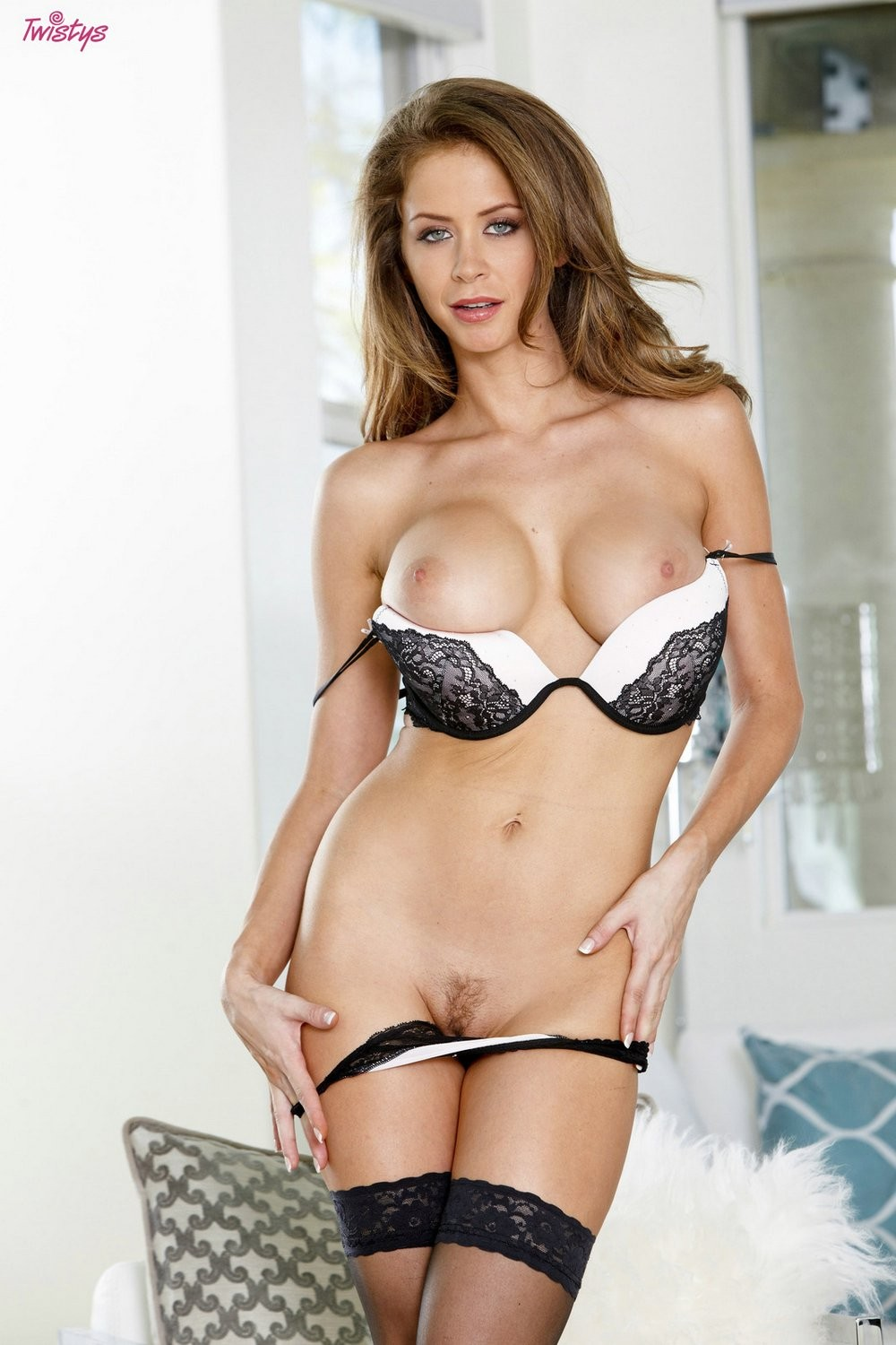 Emily addison inserts her fingers against her aroused pussy lips