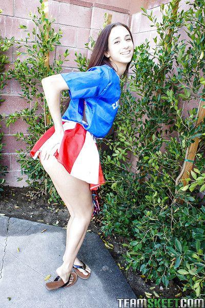 Tiny tits tenebrous teen Belle Knox is dancing beside in a cheerleader form