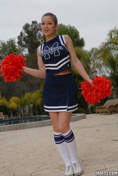 Teen cheerleader Dani Daniels pulls up her skirt to kickshaw her gloryhole