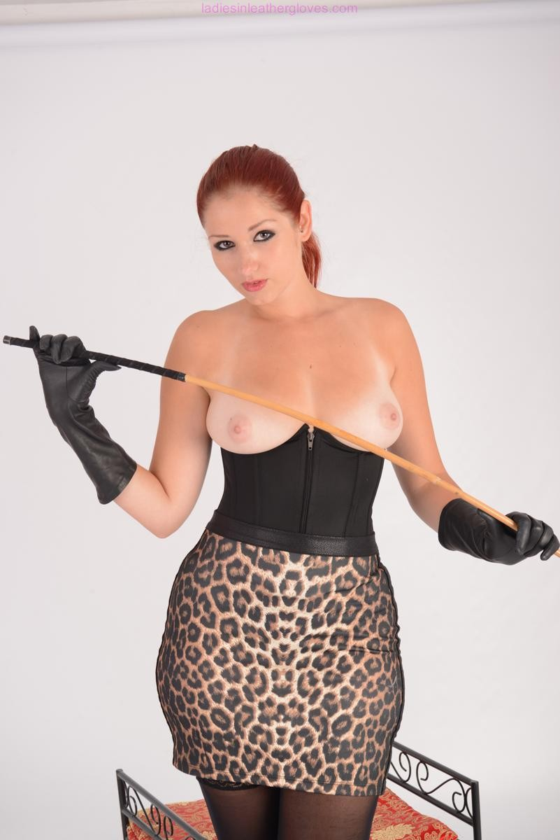 Clammy curvy extreme redhead is topless holding her bar in a short le