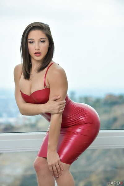 Abella Danger toys her watertight ass in wild red clothing and high heels