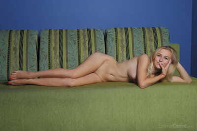 Teen blond babe lays her shaved muff on the line at the same time as posing in the as was born