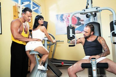 Tanned hyacinthine angelika takes two cock forth an obstacle gym