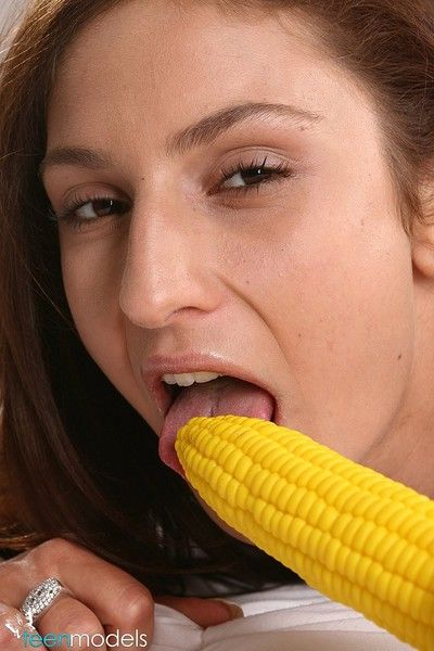 Kitty loves corn on the cob.