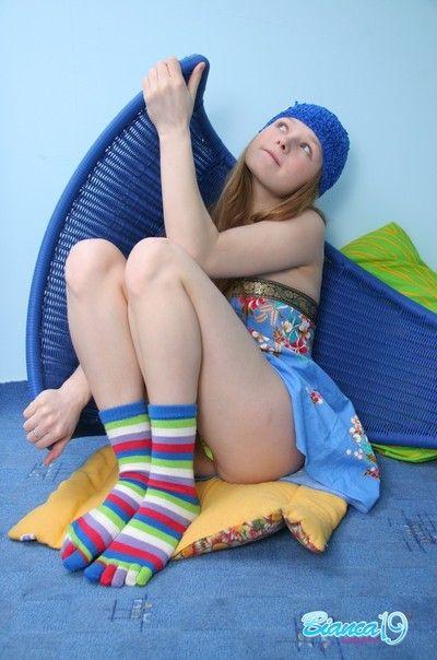 Cute nineteen realm aged teen in socks