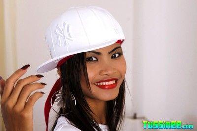 Morose brunette shows off gangsta style