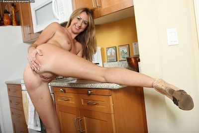 Ugly looking flaxen-haired whore Lacey undressing to show her ass increased by pussy