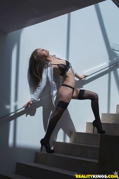 Luscious murky hottie in stockings uncovering her regimen swan around