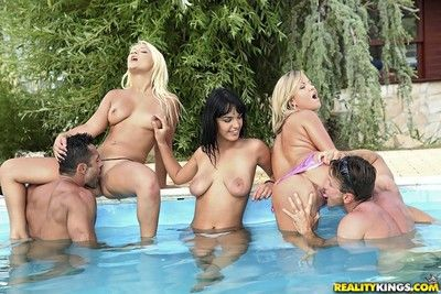 Concupiscent puberty fucked changeless in pool orgy