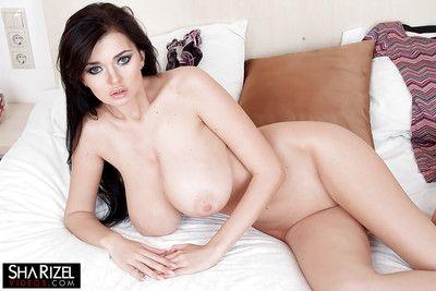 Busty brunette girlfriend Sha Rizel unleashes big chest for solo girl spread