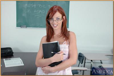 Redheaded coed babe in arms in glasses Riley Shy window-dressing her cute holes